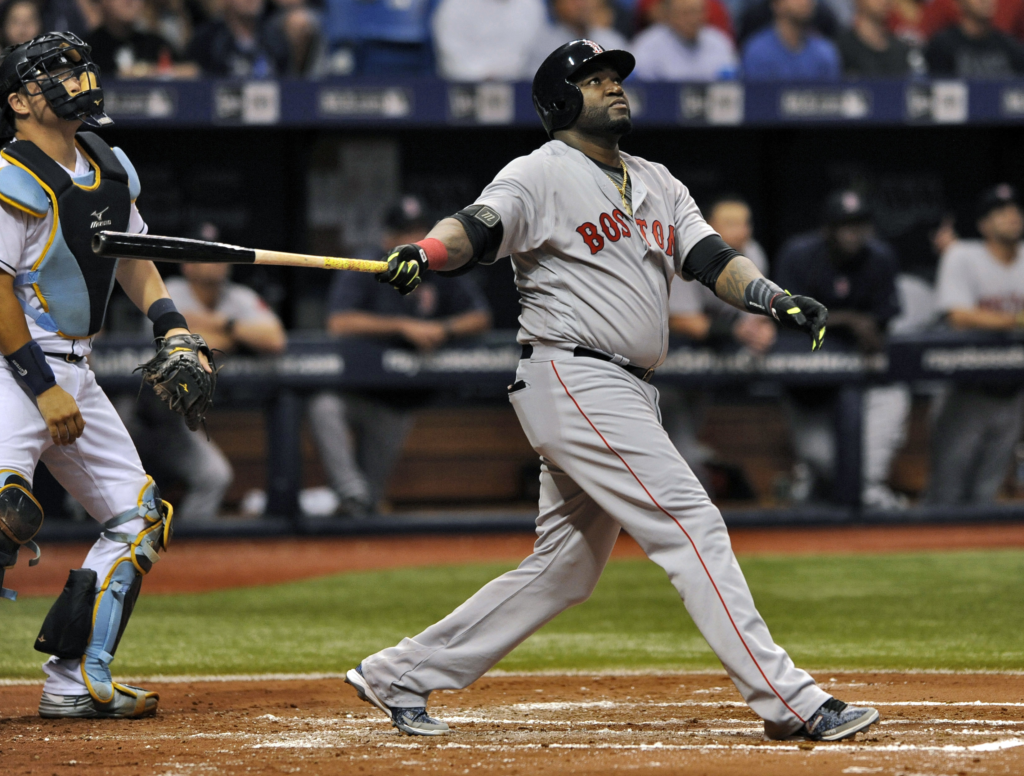 Tampa Bay Rays catcher Hank Conger, left, looks on as Boston Red Sox designated hitter David Ortiz hits a RBI-double to right field during the third inning of a baseball game Tuesday, June 28, 2016, in St. Petersburg, Fla. (AP Photo/Steve Nesius)