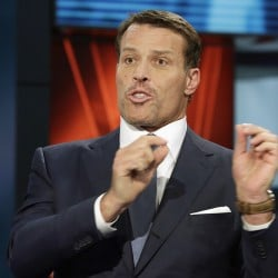 "Motivational speaker Tony Robbins appears on a segment of ""Wall Street Week"" in March. Fire walks are not uncommon at Robbins' seminars: More than 20 people were treated for foot burns after a fire walk in 2012 in San Jose. Associated Press"