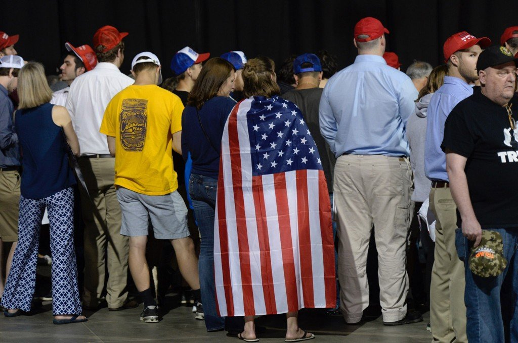People gather in the afternoon before a scheduled rally with presumptive Republican presidential nominee Donald Trump at the Cross Insurance Center in Bangor on Wednesday.