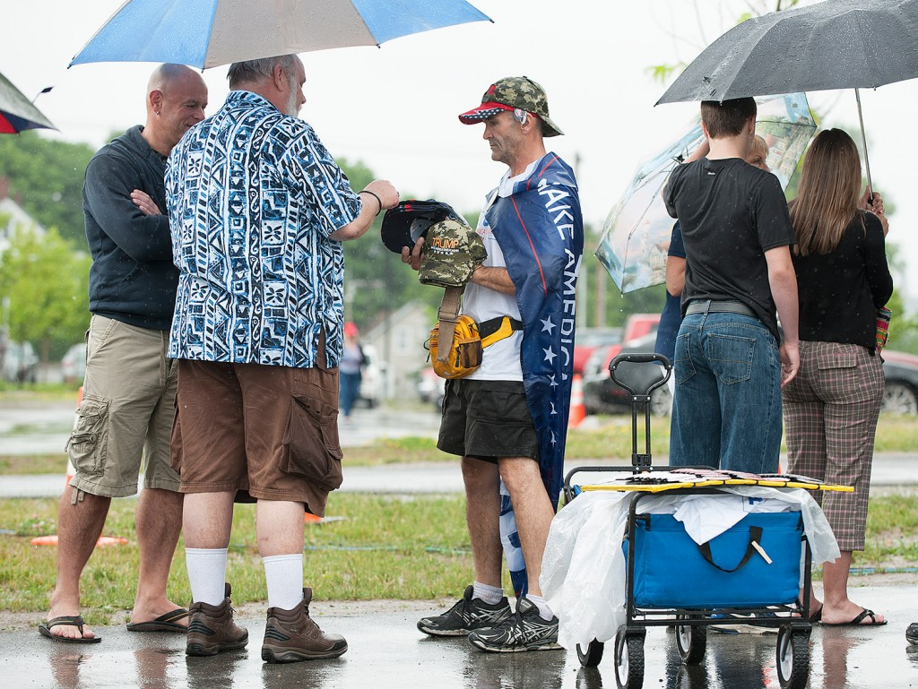 Chris Seiler of Sarasota, Fla., sells T-shirts and hats to people waiting to attend a Donald Trump rally at the Cross Insurance Center in Bangor on Wednesday. His most popular items are the Trump T-shirt and hat, which sell for $20 each, he said. Kevin Bennett Photo