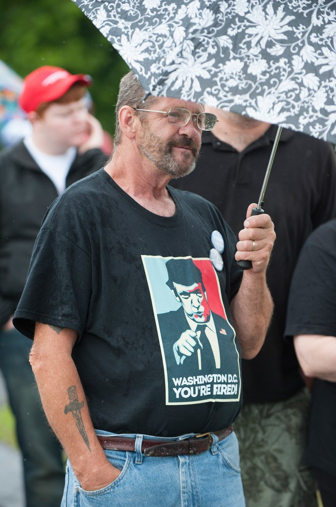 Donald Trump supporter Dennis LaChance of New Glouster waits in the rain with others to enter the Cross Insurance Center in Bangor for a Trump rally on Wednesday. Kevin Bennett Photo