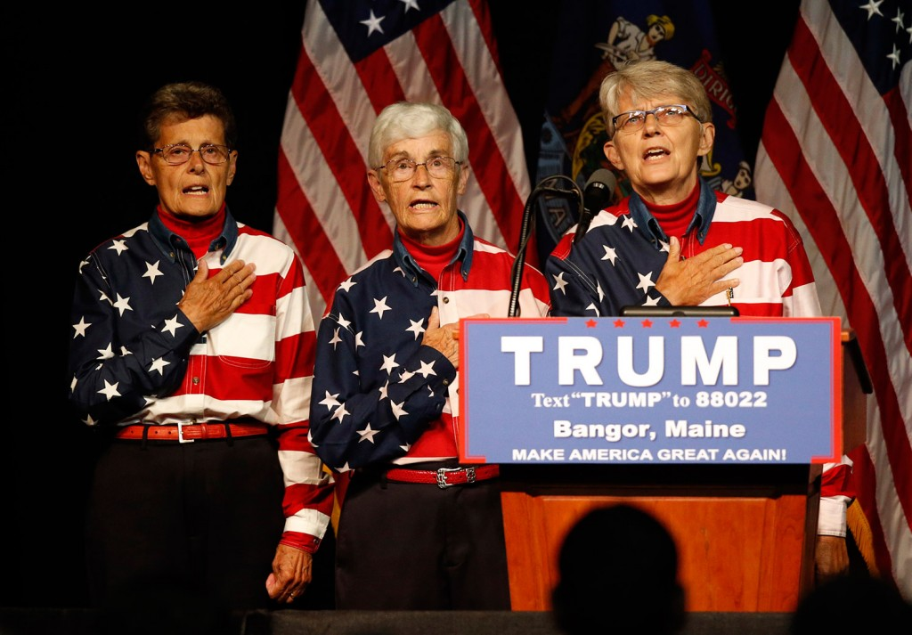 The Freeport Flag Ladies participate in a rally for Republican presidential candidate Donald Trump on Wednesday in Bangor.