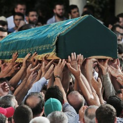 Mourners carry the coffin of Muhammed Eymen Demirci during s funeral in Istanbul's Basaksehir neighborhood. Demirci was killed Tuesday in the blasts in Istanbul's Ataturk airport. He was 25 years old and worked for ground services at the airport. Associated Press/Lefteris Pitarakis