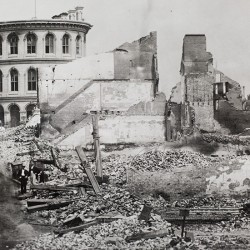 A closer view of the rubble of the north side of Exchange Street and the Custom House.