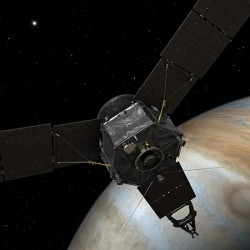 This illustration depicts NASA's Juno spacecraft at Jupiter, with its solar arrays and main antenna pointed toward the distant sun and Earth
