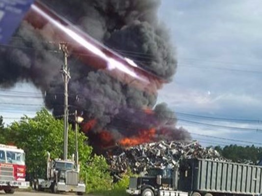 Crews Monday battled a fire at Grimmel's Industries in Topsham, which is located near the Androscoggin River. Photo courtesy of WCSH