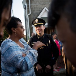 Portland Police Chief Michael Sauschuck chats with people outside Green Memorial AME Zion Church. Sauschuck said in his remarks to the audience that he believes hope will carry the day over hate and fear.