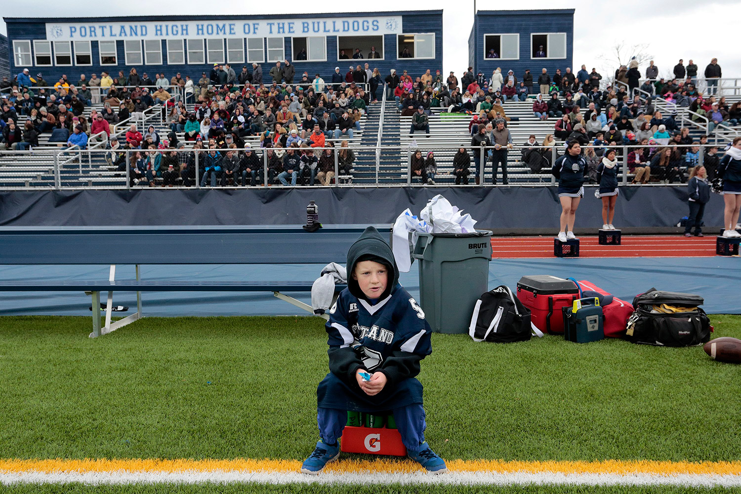 PORTLAND, ME - NOVEMBER 26: Colin O'Leary, 7, the water boy for the Portland high football team, watches the 104th annual Deering vs. Portland Thanksgiving Day football game at Fitzpatrick Stadium Thursday, November 26, 2015. (Photo by Gabe Souza/Staff Photographer)