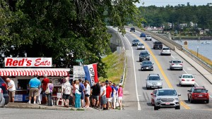 Heavy holiday traffic builds at the bridge in downtown Wiscasset as travelers line up for Red's Eats famous seafood.