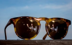 PORTLAND, ME - JULY 7: John Turner and Daniel Dougherty are reflected in a pair of Traps Eyewear sunglasses. The entreprenuers' line of sunglasses have received national attention turning salvaged wooden lobster traps into temples and earpieces. (Photo by Ben McCanna/Staff Photographer)