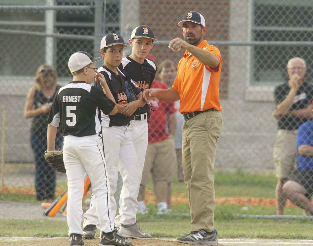 Biddeford Coach Marcus Crowell makes a pitching change in the fourth inning. Photo by Michael C. York