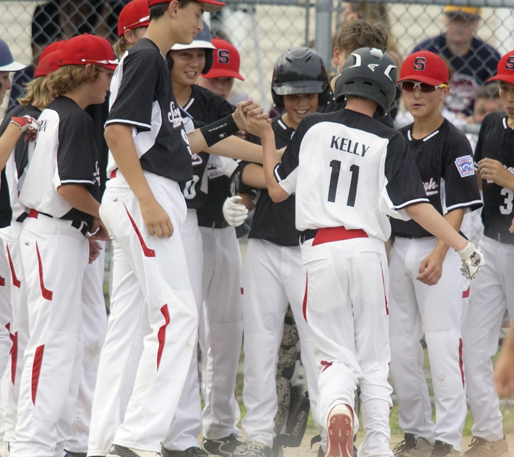 Scarborough players congratulate Ryan Kelly after hitting a home run in the third inning. Photo by Michael C. York