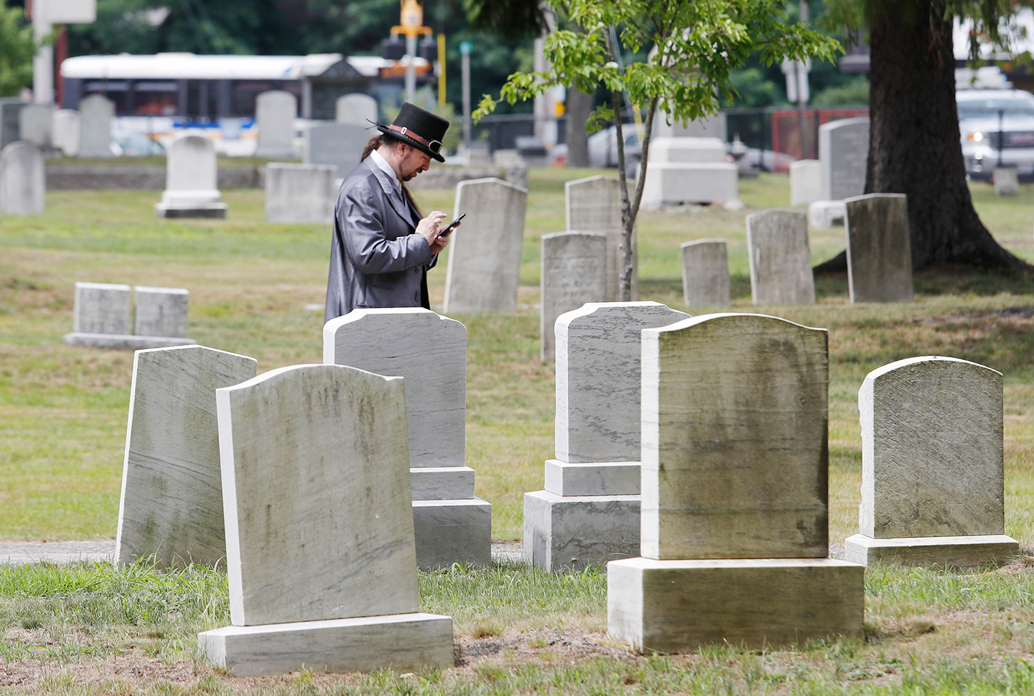 BIDDEFORD, ME Ð JULY 18: Joey Dragon plays Pokemon Go as he walks in Woodlawn Cemetery Monday, July 18, 2016 in Biddeford, Maine. (Photo by Joel Page/Staff Photographer)