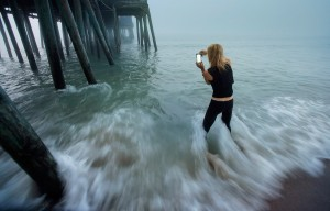 Eastman frames a photo through the pilings of The Pier.