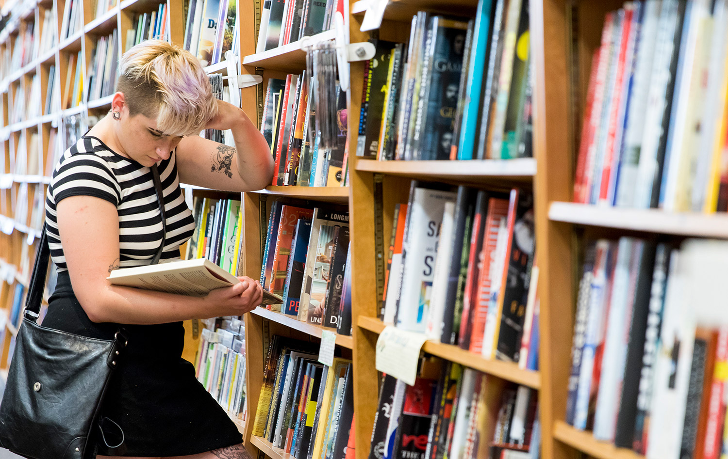 Riley Saladino of Portland flips through a book at Sherman Books on Exchange Street.