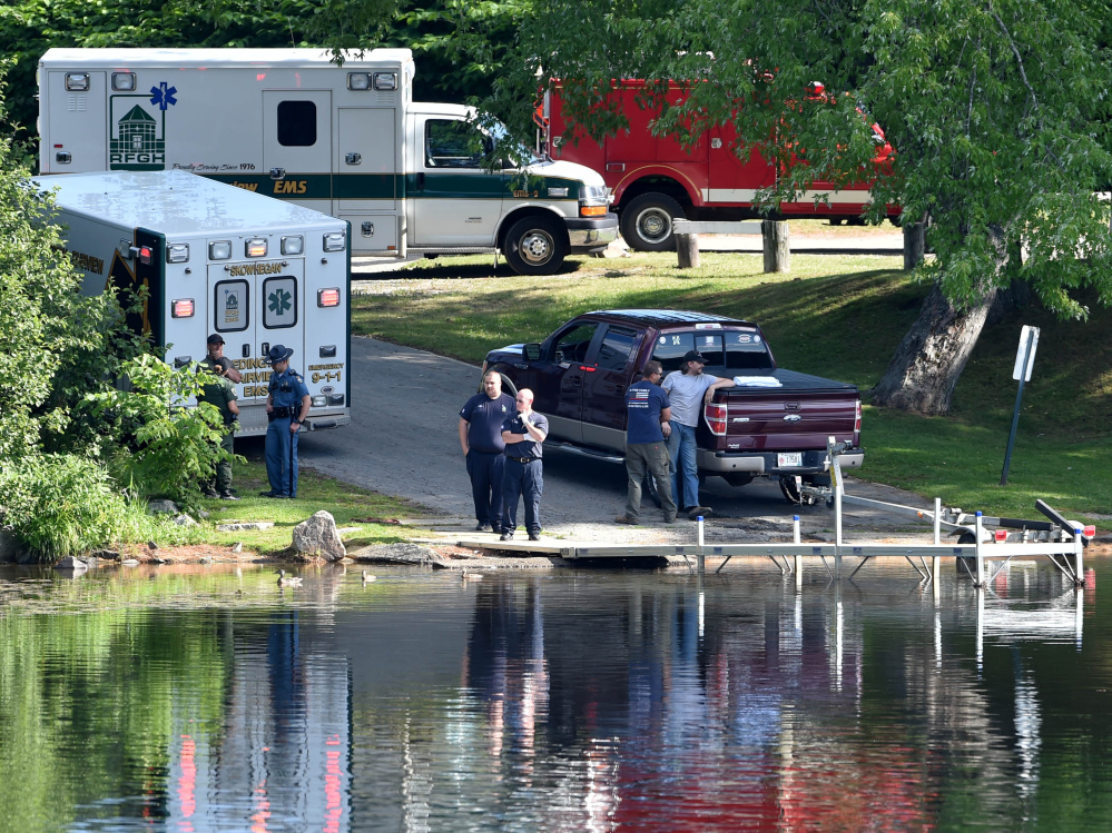 Paramedics from Redington-Fairview General Hospital, state troopers and wardens from the Maine Warden Service stand by the dock at the Oosoola Park boat landing as a crew searches for a drowning victim Thursday in the Kennebec River in Norridgewock. Barbara York was pronounced dead at the scene.