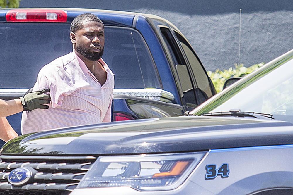 Police in Scarborough took a man into custody outside the Fairfield Inn in Scarborough Friday morning after he allegedly fled the scene of a car crash on Cummings Road.