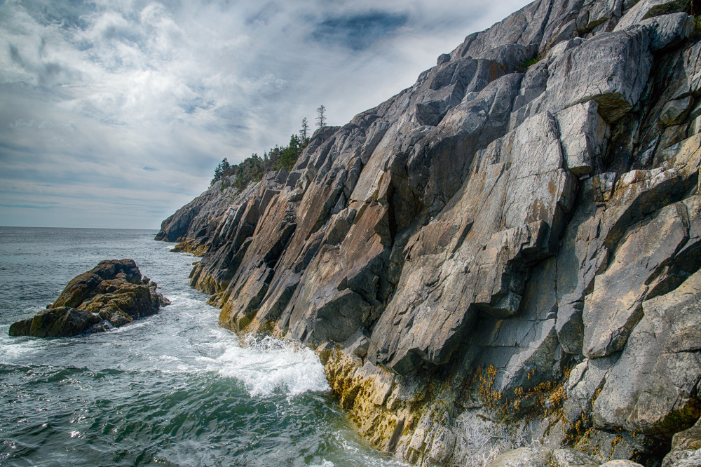 "Coastal cliffs on Isle au Haut, as seen in the new book ""Acadia National Park: A Centennial Celebration."""