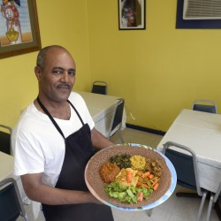 Co-owner and manager Yemane Tsegai with Red Sea's Vegetarian Sampler.