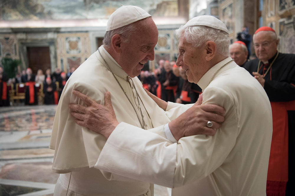 Pope Francis, left, and retired Pope Benedict XVI embrace during a ceremony to celebrate Benedict's 65th anniversary of his ordination as a priest at the Vatican on Tuesday.