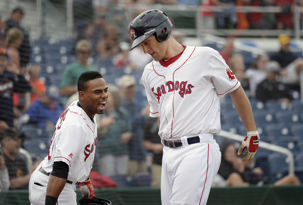 Nate Freiman, right, is greeted at by Sea Dogs' teammate Aneury Tavarez after Freiman hit his second home run of the game in Portland's 6-2 win over the Hartford Yard Goats in the first game of a doubleheader Friday at Hadlock Field.