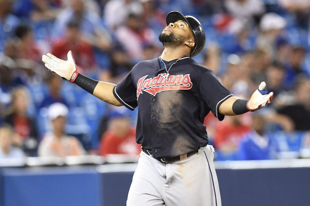Cleveland's Carlos Santana celebrates his 19th-inning home run at Toronto on Friday. The Indians held on to beat the Blue Jays, 2-1 in 19 innings to run their winning streak to 14 games.