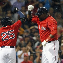 Boston's David Ortiz, right, celebrates his solo home run with Jackie Bradley Jr. in the fifth inning Friday night against the Los Angeles Angels in Boston.