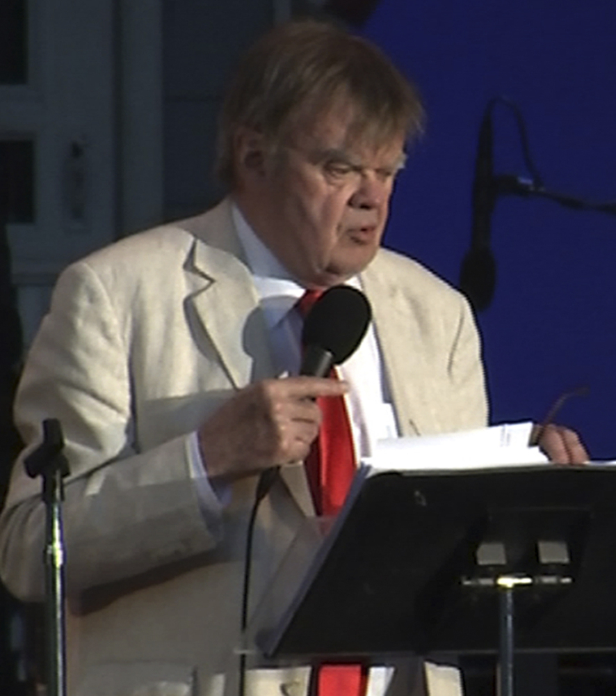 """In this image made from video, writer and humorist Garrison Keillor hosts his final broadcast of the weekly radio variety show """"A Prairie Home Companion"""" Friday at the Hollywood Bowl in Los Angeles."""