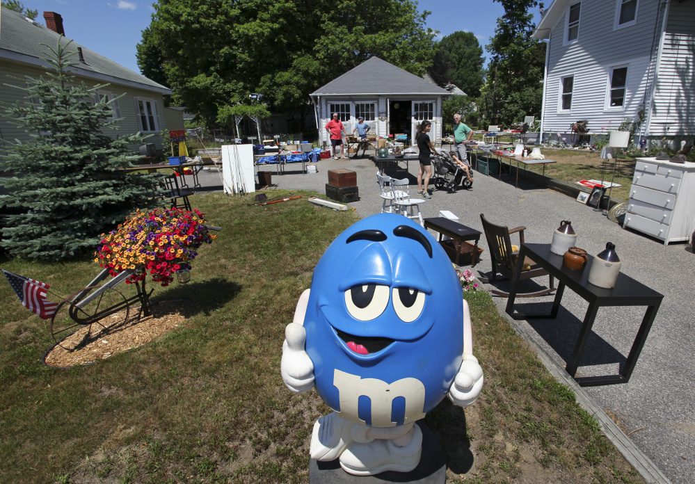 An M&M character may melt the hearts of prospective shoppers at Jim Quatrano's recent yard sale in South Portland.