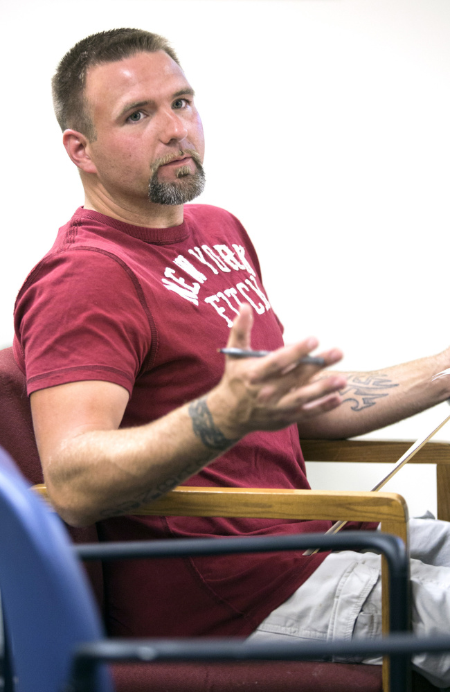 "Scott Dunbar, a recovering addict, participates in a group ""after care"" session at Mid Coast Hospital's Addiction Resource Center last month."