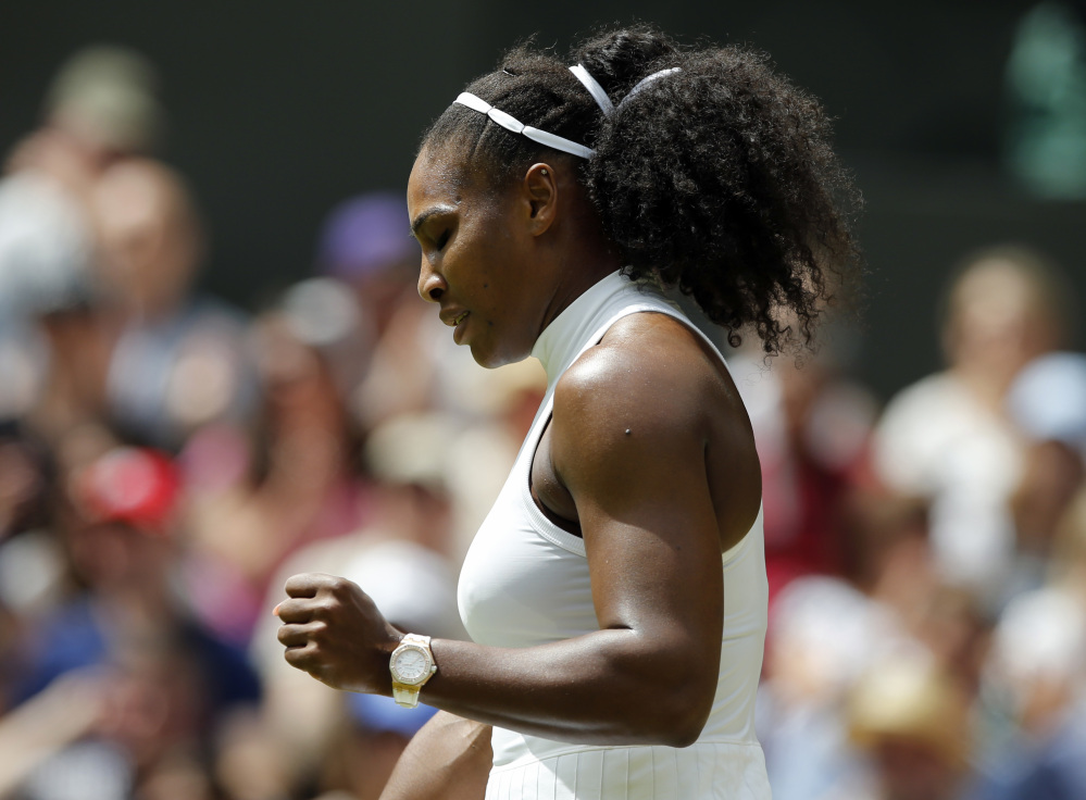 Serena Williams celebrates a point against Annika Beck during their women's singles match Sunday at Wimbledon.