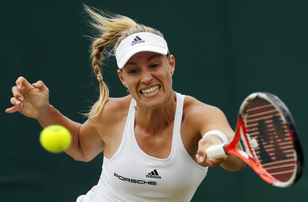 Angelique Kerber of Germany returns to Misaki Doi of Japan during their match Monday in the Wimbledon Tennis Championships in London. Kerber won easily, 6-3, 6-1, to move into the quarterfinals.