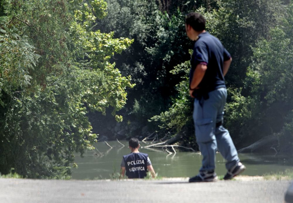 Italian police inspect the banks of the Tiber River in Rome, where the body of a college student from Wisconsin was found Monday. Beau Solomon disappeared soon after he arrived in Rome last week for an exchange program
