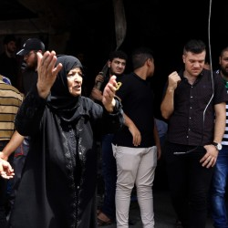 An Iraqi woman grieves Monday, a day after the bombing in Karrada, a busy shopping district in the center of Baghdad. Iraqis went on social media to vent their anger about the fake bomb detectors that have weakened security.