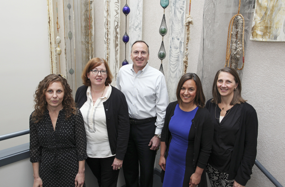 Besides CEO Ted Wirth, center, other top managers at  Diversified Communications include, from left, Amelie Veegaert, operations manager; Mary Larkin, executive vice president; Liz Plizga, vice president-group event director; and Christine Pederson, marketing director.