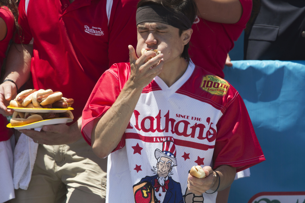 Associated Press/Mary Altaffer Matt Stonie competes in Nathan's Famous Fourth of July International Hot Dog Eating Contest men's competition Monday in New York. Stonie came in second, eating 53 hot dogs and buns in 10 minutes.