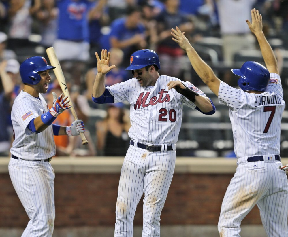 James Loney, from left, Neil Walker and Travis d'Arnaud celebrate at home after a two-run double by Yoenis Cespedes in the Mets' win Monday at New York.