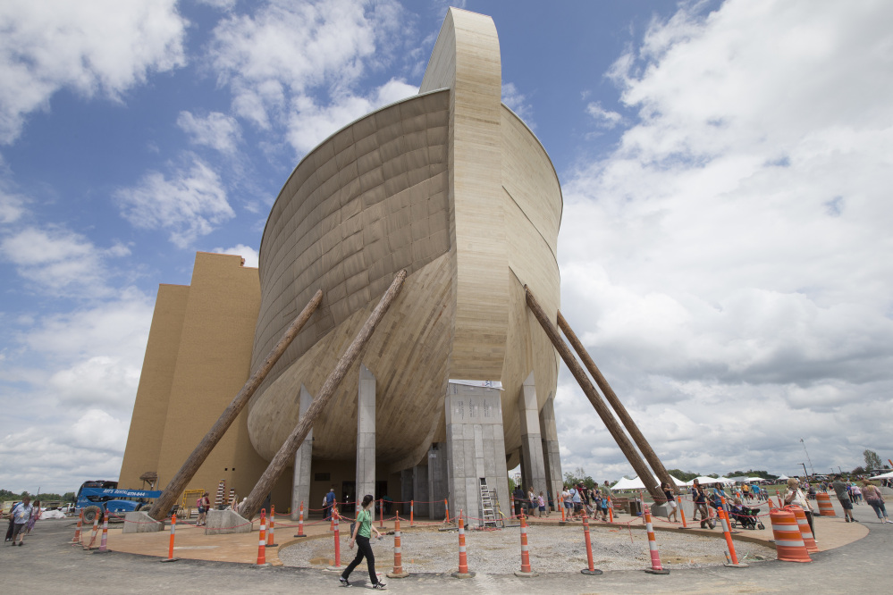 Visitors pass outside the replica Noah's ark at the Ark Encounter during a media preview day, Tuesday, in Williamstown, Ky. The long-awaited theme park will open Thursday. Opponents say the attraction will be detrimental to science education.