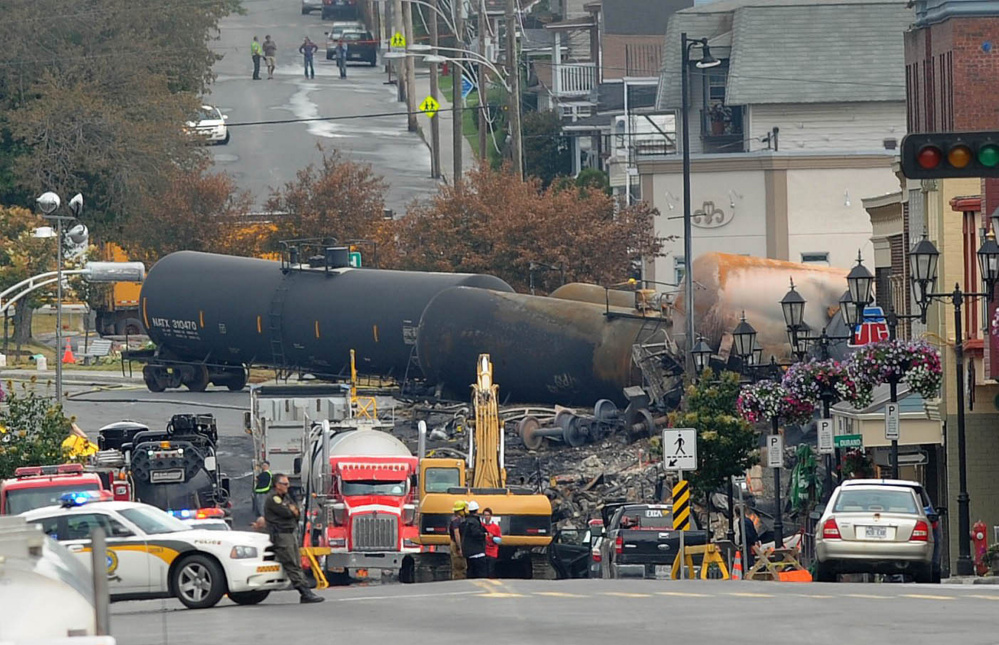 Crude oil tankers from the Montreal, Maine & Atlantic railway are seen July 9, 2013, in the heart of downtown Lac-Megantic, Quebec, where the runaway train exploded, killing 47 on July 6 of that year.