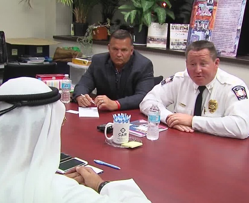 Avon Police Chief Richard Bosley, right, and Mayor Bryan Jensen apologize to Ahmed al-Menhali, after he collapsed following an encounter with police in Avon, Ohio. Al-Menhali's treatment outside a hotel in Avon, Ohio, became front-page news in the Emirates, a key U.S. ally that is home to the commercial hub of Dubai, and prompted the federation's government to formally summon a U.S. diplomat for an explanation.