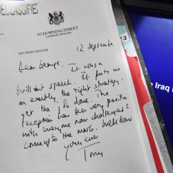 A detail of a declassified handwritten letter sent by British Prime Minister Tony Blair to U.S. President George W. Bush is shown as part of the Iraq Inquiry Report presented by Sir John Chilcot at the Queen Elizabeth II Centre  in London on Wednesday.