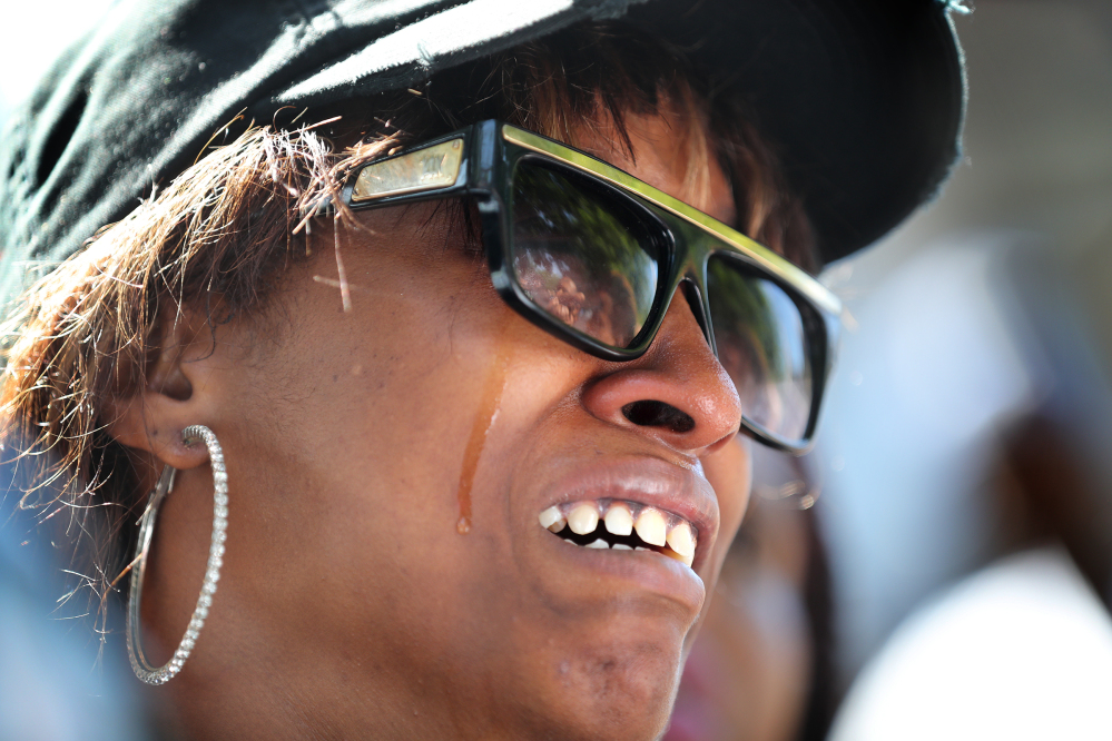 Diamond Reynolds, the girlfriend of Philando Castile, weeps during a press conference Thursday in St. Paul, Minn. Castile was shot in a car Wednesday night by police in the St. Paul suburb of Falcon Heights, and Reynolds streamed the aftermath live on Facebook.