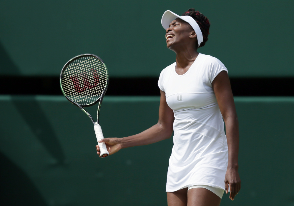 Venus Williams of the U.S reacts during her women's singles match against Angelique Kerber of Germany on day eleven of the Wimbledon Tennis Championships in London.