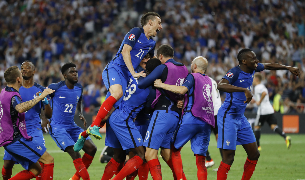 France's players celebrate after Antoine Griezmann scored his team's second goal during the Euro 2016 semifinal soccer match between Germany and France, at the Velodrome stadium in Marseille, France on Thursday. France won, 2-0, and advanced to Sunday's final against Portugal.