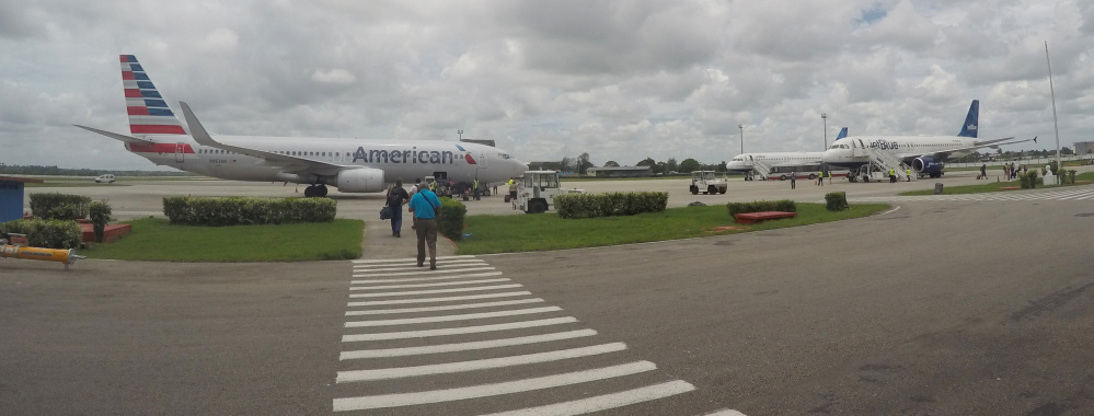 American Airlines and JetBlue Airways charter flights wait to depart from Havana's Jose Marti International Airport on June 10. A move to allow commercial airlines to fly to Cuba is the latest development in President Obama's effort to normalize U.S.-Cuba relations.