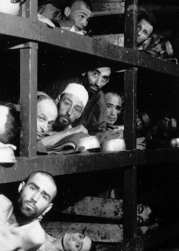 This 1945 file photo provided by the Army shows inmates of Buchenwald inside their barracks, a few days after U.S troops liberated the concentration camp near Weimar. The young man fourth from left in the middle row bunk is Elie Wiesel, who would later become an author and Nobel Peace Prize laureate.
