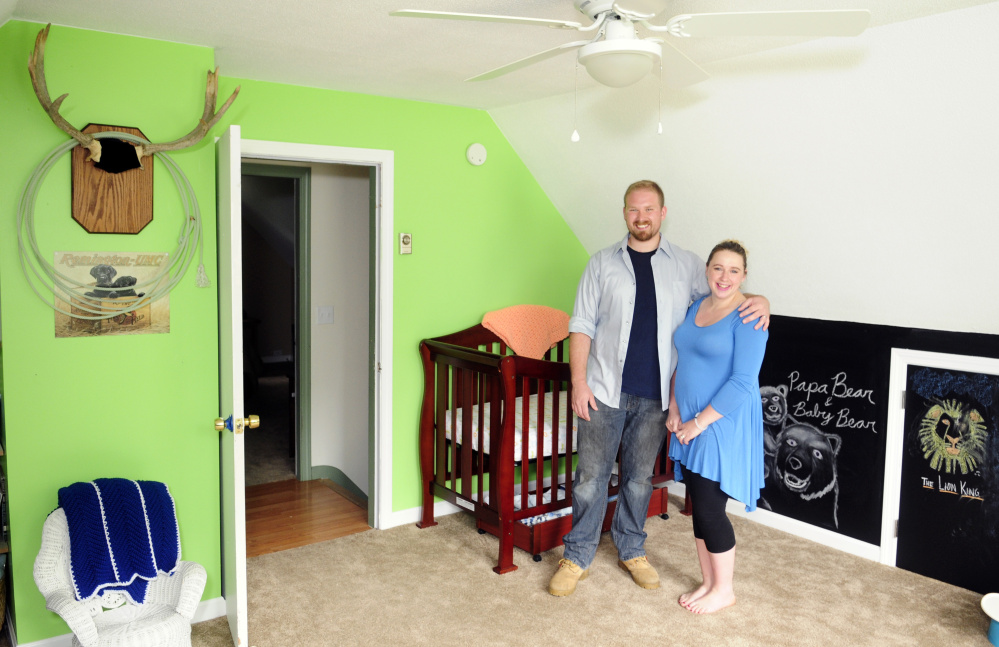 New homeowners Steven and Abby Utecht stand in the nursery of their new home Friday in Richmond.