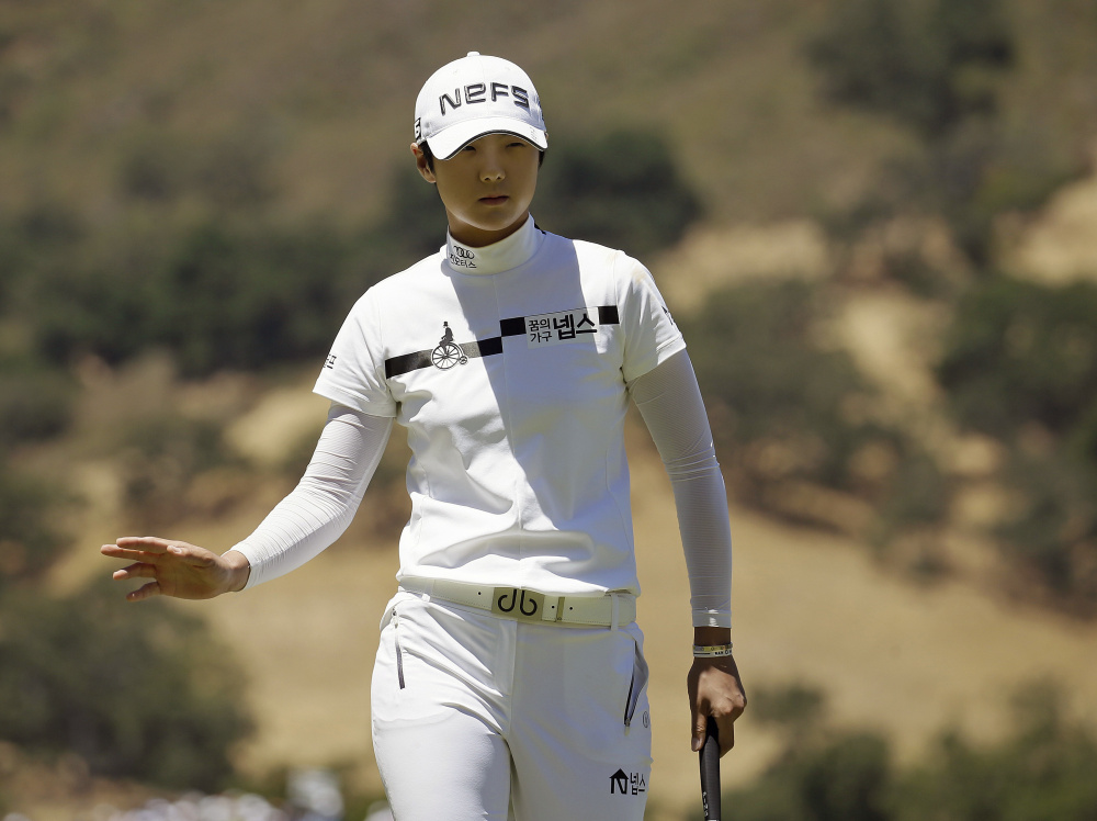 Sung Hyun Park waves after making a birdie putt on the 16th hole during the second round of the U.S. Women's Open on Friday in San Martin, California. Park shot a 6-under 66 to grab a two-stroke lead.