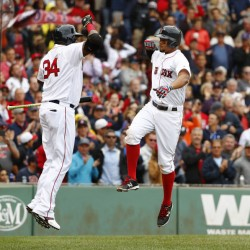 Xander Bogaerts, right, celebrates his two-run home run with teammate David Ortiz during the fourth inning =against the Tampa Bay Rays on Saturday. The Red Sox won, 4-1.