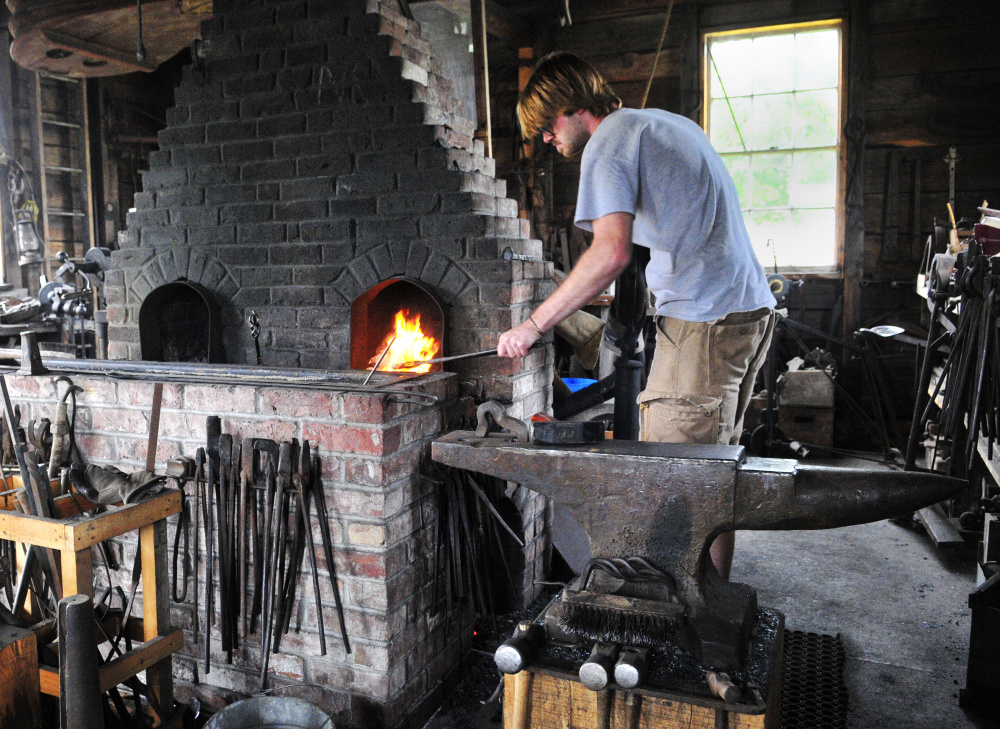 Robert Stevens works in the blacksmith shop at the Windsor Fairgrounds.